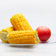 Corn Cobs and tomato on a glass plate. Small DOF — Stock Photo