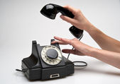 Vintage telephone being picked up — Stock Photo