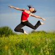 Woman jumping on a sunset — Stock Photo