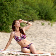 Young woman sunbathing — Stock Photo