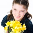 Cute little girl giving flowers — Stock Photo