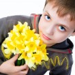 Cute little boy giving flowers - Stock Photo