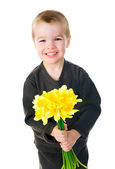 Cute little boy giving flowers — Stok fotoğraf