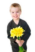 Cute little boy giving flowers — Stok fotoğraf