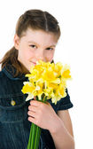 Cute little girl giving flowers — Stock Photo