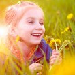 Cute little girl on the meadow — Stock Photo #5589081