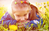 Cute little girl on the meadow — Stok fotoğraf