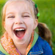 Cute little girl on the meadow — Stock Photo #5650617