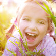 Cute little girl on the meadow — Stock Photo #5681841