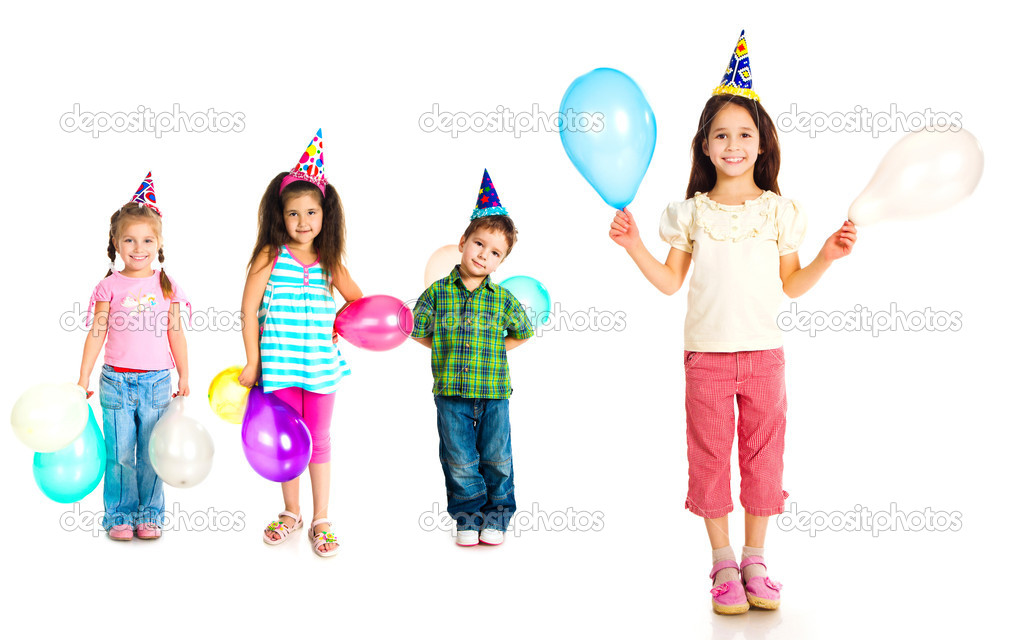 Kids in birthday caps isolated on white  Stock Photo #5681900
