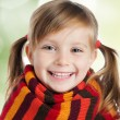 Royalty-Free Stock Photo: Little girl in striped scarf
