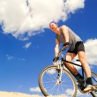 Young men riding a bike — Stock Photo #5817090