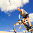 Stock Photo: Young men riding a bike