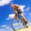 Young men riding a bike — Stock Photo #5817092