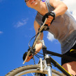 Young men  riding a bike — Stock Photo