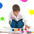 Cute little boy covered in bright paint — Stock Photo