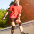 Stock Photo: Young active roller blade skater