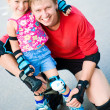 Dad with his daughter on the skates — Stock Photo #6162846