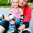 Dad with his daughter on the skates — Stock Photo