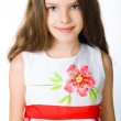 Little girl in red dress — Stock Photo