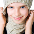 Little girl in cap and scarf - Stok fotoğraf