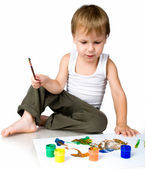 3 year old boy covered in bright paint — Stock Photo
