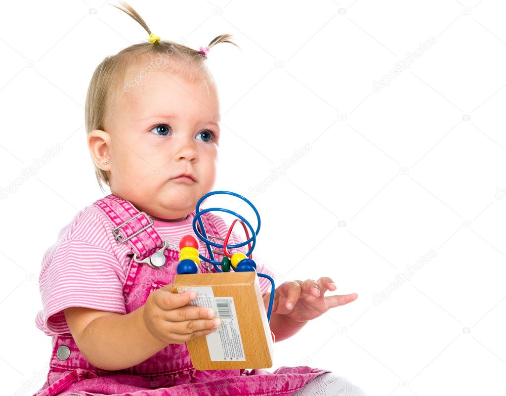 Small baby with developmental toy on a white background — Stock Photo #6349884