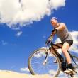 Young men riding a bike — Stock Photo