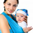 Stock Photo: Mother carrying her baby in a sling