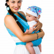 Mother carrying her baby in a sling — Stock Photo