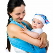 Mother carrying her baby in a sling — Stock Photo #6500553
