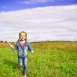 Girl on grass in summer day — Stock Photo #6500734