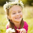 Little girl in wreath of flowers — Stock Photo #6500796