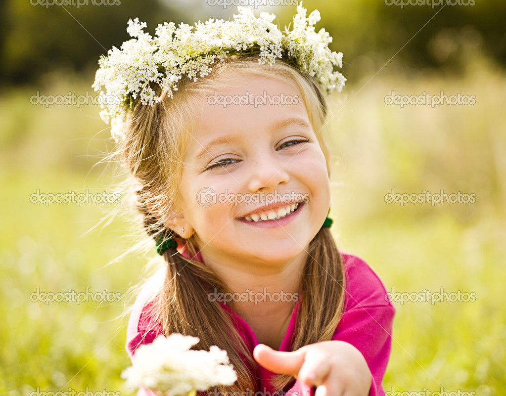 little girl in wreath of flowers stock photo tan4ikk