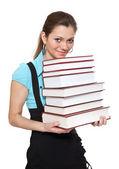 Bela estudante está segurando um monte de livros — Foto Stock