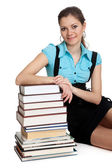 Beautiful student is holding a lot of books — Stock Photo