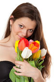 Beauty girl holding bouquet of tulips — Fotografia Stock
