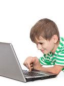Chłopiec trzyma laptopa — Zdjęcie stockowe