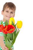 Young boy holding tulips — Foto Stock