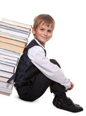 Boy and books — Stockfoto