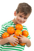 Boy holding oranges — Stock Photo