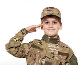 Saluting soldier. Young boy — Zdjęcie stockowe