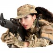 Beautiful army girl with rifle is aiming - Stock Photo