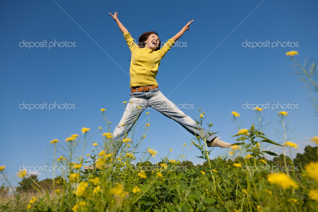 Happy and beautiful young girl jumping high in a summer field   Stock Photo #6459881