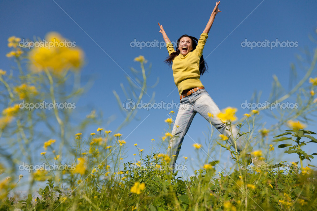 Happy and beautiful young girl jumping high in a summer field  — Stock Photo #6459889