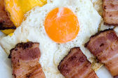 Fried bacon with eggs — Stock Photo