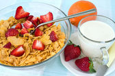 Cornflakes with strawberry and milk — Stock Photo