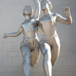 Sculpture of  running women — Stock Photo