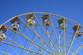 Ferris wheel against blue — Stock Photo