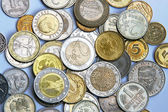 Different currency and coins as a background — Stock Photo